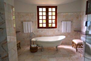 A ceramic bathtub in a bathroom